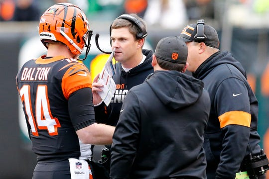 Cincinnati Bengals head coach Zac Taylor and quarterback Andy Dalton (14) talk during a timeout in the second quarter of the NFL Week 13 game between the Cincinnati Bengals and the New York Jets at Paul Brown Stadium in downtown Cincinnati on Sunday, Dec. 1, 2019. The Bengals led 17-6 at halftime.