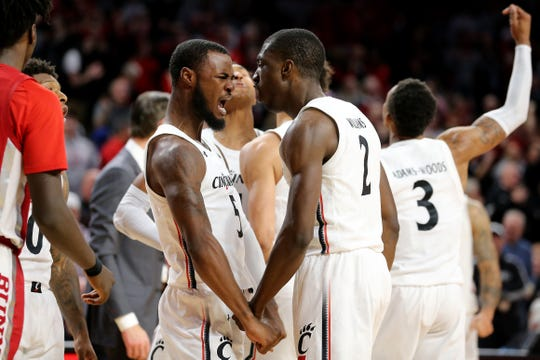 Cincinnati Bearcats guard Trevor Moore (5) and Cincinnati Bearcats guard Keith Williams (2) celebrate a put-back dunk in the second half of a college basketball game against the UNLV Rebels, Saturday, Nov. 30, 2019, at Fifth Third Arena in Cincinnati.