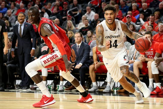 Cincinnati Bearcats guard Jarron Cumberland (34) drives to the basket as UNLV Rebels forward Cheikh Mbacke Diong (34) defends in the first half of a college basketball game, Saturday, Nov. 30, 2019, at Fifth Third Arena in Cincinnati.