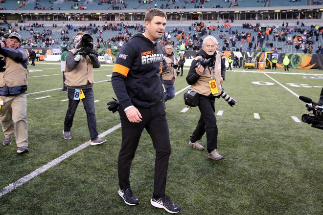 Cincinnati Bengals head coach Zac Taylor walks off the field after earning his first win as head coach against the New York Jets in a Week 13 NFL game, Sunday, Dec. 1, 2019, at Paul Brown Stadium in Cincinnati. The Cincinnati Bengals won 22-6, and improved to 1-11 on the season.