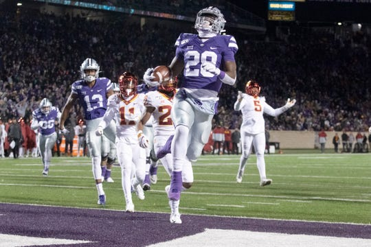 Nov 30, 2019; Manhattan, KS, USA; Kansas State Wildcats running back Jacardia Wright (28) celebrates after scoring a touchdown in the second quarter against the Iowa State Cyclones at Bill Snyder Family Stadium. Mandatory Credit: Scott Sewell-USA TODAY Sports