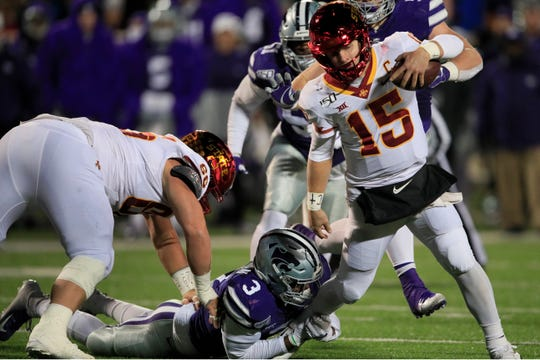 Iowa State quarterback Brock Purdy (15) is tackled by Kansas State linebacker Elijah Sullivan (3) during the first half of an NCAA college football game in Manhattan, Kan., Saturday, Nov. 30, 2019. (AP Photo/Orlin Wagner)