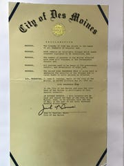 In 1993, Des Moines Mayor John Dorrian signed an Aids Awareness Week proclamation.