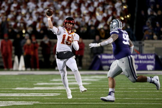 Nov 30, 2019; Manhattan, KS, USA; Iowa State Cyclones quarterback Brock Purdy (15) throws the ball against Kansas State Wildcats defensive tackle Trey Dishon (99) during the first quarter of a game at Bill Snyder Family Stadium. Mandatory Credit: Scott Sewell-USA TODAY Sports