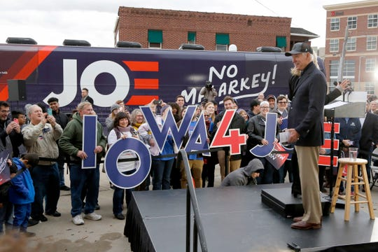 Democratic presidential candidate and former Vice President Joe Biden turns to supporters as he is introduced by his wife Jill Biden, during a campaign stop in Council Bluffs, Iowa, Saturday, Nov. 30, 2019. (AP Photo/Nati Harnik)