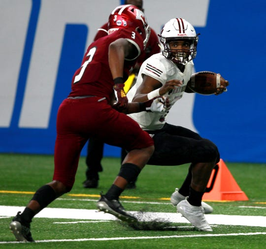 River Rouge #5 Mareyohn Hrabowski tries to come to a stop and let the Muskegon defense of #3 Julius Sims run by him in the fourth quarter of the Division 3 state championship football game against Muskegon at Ford Field on Saturday, Nov. 30, 2019. River Rouge won the game 30-7 to win their first ever state football championship.