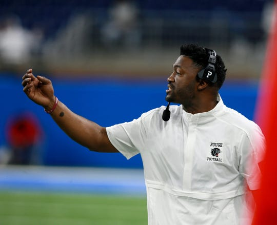 River Rouge head football coach Corey Parker yells out instructions to his offense during the second half of the Division 3 state championship football game between Muskegon and River Rouge at Ford Field on Saturday, November 30, 2019.