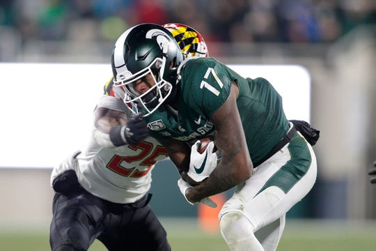 Michigan State's Tre Mosley runs on a pass reception against Maryland's Antoine Brooks Jr. during the second half Saturday, Nov. 30, 2019, in East Lansing. MSU won 19-16.