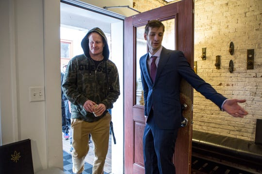 Nick St. Onge, 27 of Clinton Twp. is welcomed by store manager Al Moroz, on the first day of legal marijuana sales in Michigan at Arbors Wellness in Ann Arbor, Mich., Sunday, Dec. 1, 2019.