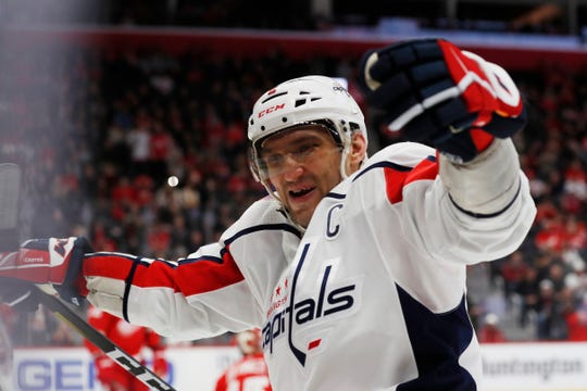 Washington Capitals left wing Alex Ovechkin celebrates a teammate's goal during the third period against the Detroit Red Wings, Saturday, Nov. 30, 2019, in Detroit.