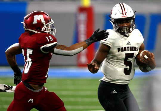 River Rouge #5 Mareyohn Hrabowski gets ready for the hit by Muskegon #16 Myles Walton in the fourth quarter of the Division 3 state championship football game against Muskegon at Ford Field on Saturday, Nov. 30, 2019. River Rouge won the game 30-7 to win their first ever state football championship.