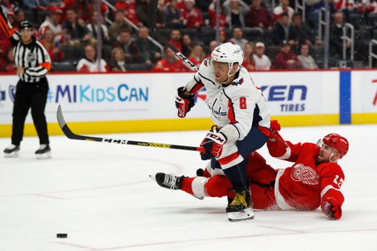 Washington Capitals left wing Alex Ovechkin draws a penalty from Detroit Red Wings defenseman Filip Hronek as he shoots and scores during the third period Saturday, Nov. 30, 2019, in Detroit. Ovechkin had a hat trick.