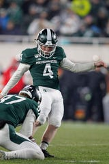 Michigan State's Matt Coghlin kicks a field goal against Maryland during the fourth quarter.