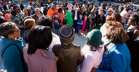 Attendees gather to have their photos made with the Rosa parks statue after its unveiling in downtown Montgomery, Ala.