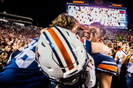 Auburn tight end Phelps Gambill (89) celebrates with a fan after the team defeated Alabama 48-45.