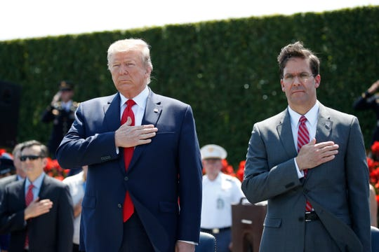 President Donald Trump and Secretary of Defense Mark Esper, right, stand during the playing of the National Anthem, during a ceremony for Esper July 25 at the Pentagon.