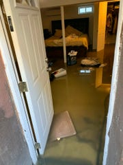 In this photo provided by Cynthia McKenvie is sewage backup that flooded her home, Saturday, Nov. 30, 2019, in the Jamaica, Queens section of New York.