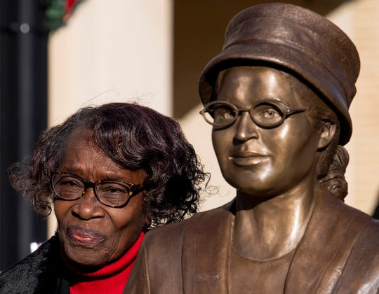 Mary Louise Smith, a plaintiff in the Browder vs. Gayle case that desegregated buses in Montgomery, stands beside the Rosa Parks statue after its unveiling event in downtown Montgomery, Ala., Sunday.