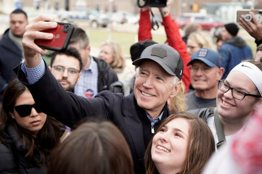 Democratic presidential candidate and former Vice President Joe Biden takes a selfie with supporters following a campaign stop in Council Bluffs, Iowa, Saturday, Nov. 30, 2019.