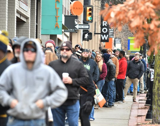 A line stretches about a block from Arbors Wellness in Ann Arbor, Mich. on Dec. 1, 2019, the first day of legal recreational marijuana sales in Michigan.