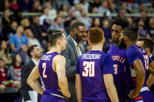 Evansville Head Coach Walter McCarty talks to his team at the Evansville vs IUPUI game at Indiana Farmers Coliseum in Indianapolis, Ind., Saturday, Nov. 30, 2019.
