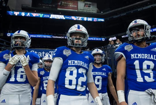 Memorial walks onto the field before the Evansville Memorial vs East Noble IHSAA Class 4A State Championship game at Lucas Oil Stadium in Indianapolis, Ind., Saturday, Nov. 30, 2019. Memorial won the state title in a 21-3 victory over East Noble.