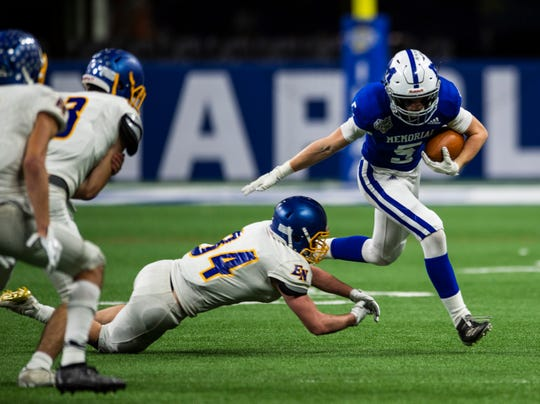 East Noble Knights' Jacob VanGorder (34) falls short of tackling Memorial's Dawson Hurley (5) at the Evansville Memorial vs East Noble IHSAA Class 4A State Championship game at Lucas Oil Stadium in Indianapolis, Ind., Saturday, Nov. 30, 2019. Memorial won the state title in a 21-3 victory over East Noble.