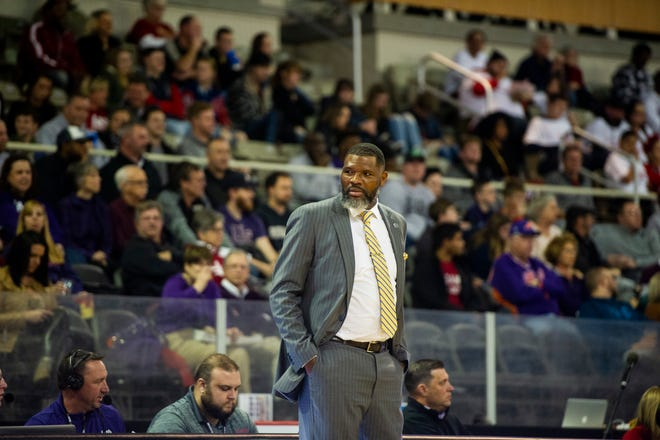 Walter McCarty, then-coach for the University of Evansville, watches the Purple Aces from the sidelines at the Evansville vs IUPUI game at Indiana Farmers Coliseum in Indianapolis on Saturday, Nov. 30, 2019.