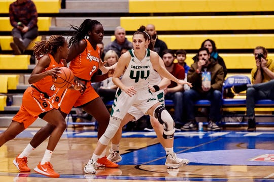 Former Algoma star Anna Dier and the UWGB women pulled off an upset against No. 18 Syracuse on Saturday.