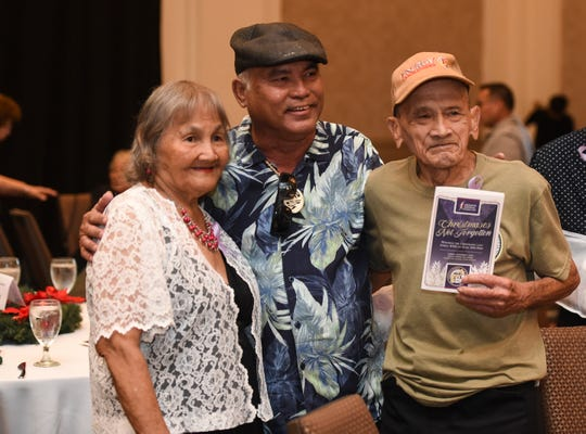"Ricardo Sablan, a percussionist for Johnny Sablan and the Agat Serenaders, poses for a photo with war survivors Brigida C. Mojica and Juan Quintanilla Guzman during the Mañenggon Memorial Foundation's ""Christmases Not Forgotten"" event at Sheraton Laguna Guam Resort in Tamuning, Dec. 1, 2019."