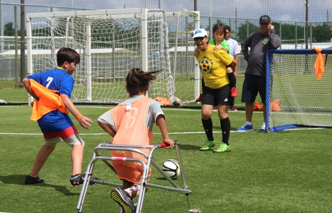 Athletes take part in a small-sided game during the Guam Football Association Special Olympics Guam Unified Soccer Jamboree Saturday at the GFA National Training Center.