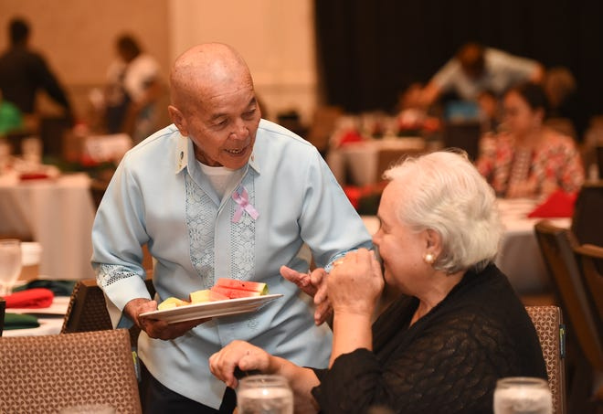 """Guests mingle during the Mañenggon Memorial Foundation's """"Christmases Not Forgotten"""" event at Sheraton Laguna Guam Resort in Tamuning in this Dec. 1 file photo."""