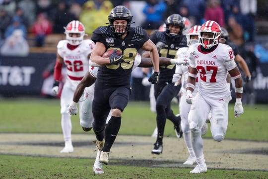 Purdue tight end Brycen Hopkins runs downfield as IU defenders chase.