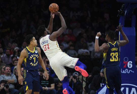 Philadelphia 76ers center Joel Embiid (21) attempts a shot as Indiana Pacers center Myles Turner (33) defends during the first quarter at Wells Fargo Center.