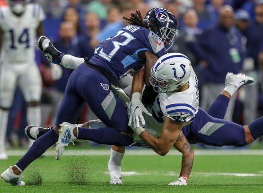 Indianapolis Colts tight end Ross Travis (43) fumbles late in the game against the Tennessee Titans at Lucas Oil Stadium on Sunday, Dec. 1, 2019.