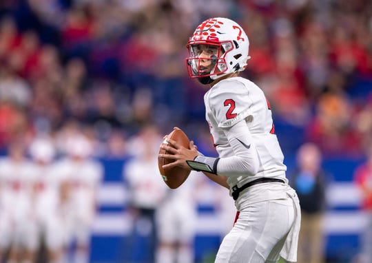 Center Grove High School sophomore Tayven Jackson (2) looks to pass during the second half of action in the 47th annual IHSAA class 6A football state finals at Lucas Oil Stadium, Saturday, Nov. 30, 2019. Carmel won 20-17.