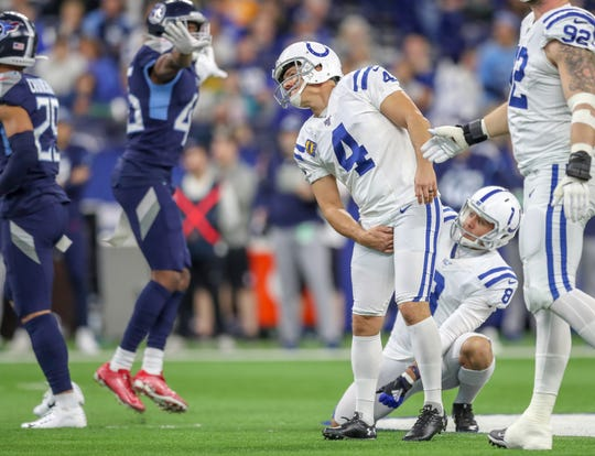 Indianapolis Colts kicker Adam Vinatieri (4) leans into a missed field goal against the Tennessee Titans at Lucas Oil Stadium on Sunday, Dec. 1, 2019.