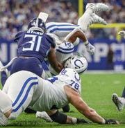 Indianapolis Colts running back Nyheim Hines (21) is flipped after getting hit on a run in the second quarter against the Tennessee Titans at Lucas Oil Stadium on Sunday, Dec. 1, 2019.