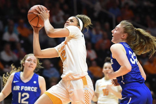 Tennessee's Rae Burrell (12) gets a shot off while guarded by Air Force's  Kaelin Immel (32) during the NCAA women's basketball game on Sunday, December 1, 2019 at Thompson-Boling Arena