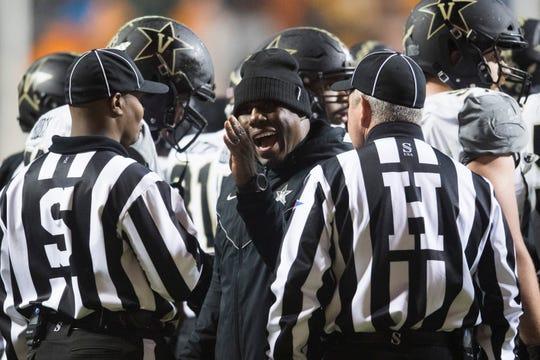 Vanderbilt head coach Derek Mason speaks to officials during a game between Tennessee and Vanderbilt at Neyland Stadium, Saturday, Nov. 30, 2019.