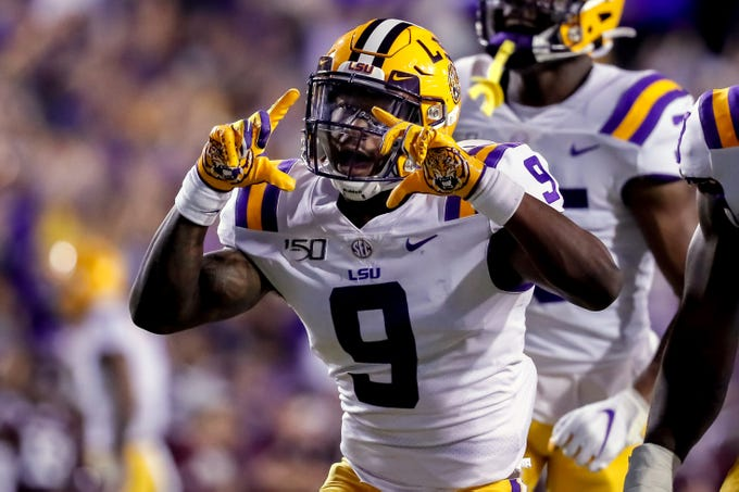 Nov 30, 2019; Baton Rouge, LA, USA; LSU Tigers safety Marcel Brooks (9) reacts after a sack of Texas A&M Aggies quarterback Kellen Mond (not pictured) by linebacker K'Lavon Chaisson (not pictured) during the first quarter at Tiger Stadium. Mandatory Credit: Stephen Lew-USA TODAY Sports