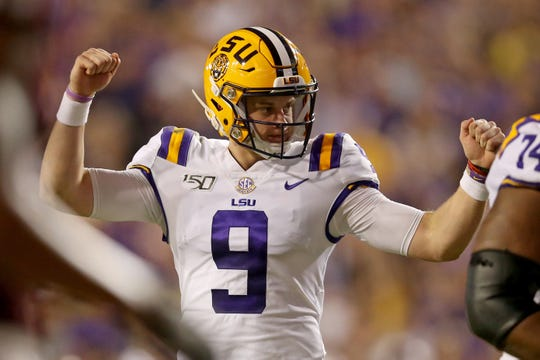 Nov 30, 2019; Baton Rouge, LA, USA; LSU Tigers quarterback Joe Burrow (9) gestures after a touchdown against the Texas A&M Aggies in the second quarter at Tiger Stadium. Mandatory Credit: Chuck Cook-USA TODAY Sports