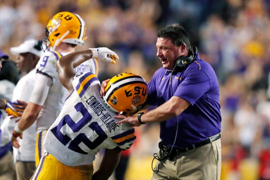 LSU coach Ed Orgeron celebrates with running back Clyde Edwards-Helaire (22) after a touchdown during the second half of the team's NCAA college football game against Texas A&M in Baton Rouge, La., Saturday, Nov. 30, 2019. LSU won 50-7. (AP Photo/Gerald Herbert)