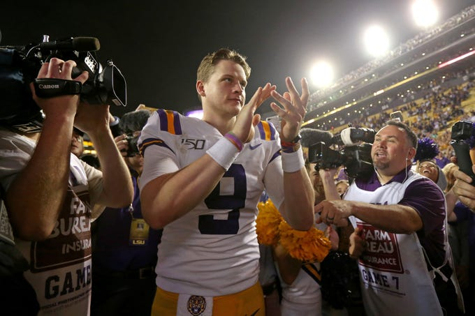 Nov 30, 2019; Baton Rouge, LA, USA; LSU Tigers quarterback Joe Burrow (9) acknowledges the crowd at Tiger Stadium after defeating the Texas A&M Aggies. LSU won 50-7. Mandatory Credit: Chuck Cook-USA TODAY Sports