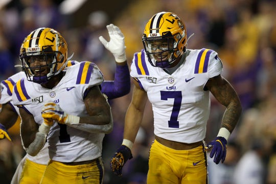Nov 30, 2019; Baton Rouge, LA, USA; LSU Tigers safety Grant Delpit (7) celebrates after making a second half interception against the Texas A&M Aggies at Tiger Stadium. Mandatory Credit: Chuck Cook-USA TODAY Sports