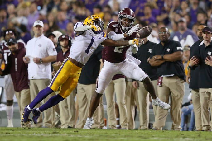 Nov 30, 2019; Baton Rouge, LA, USA; LSU Tigers cornerback Kristian Fulton (1) breaks up a pass intended for Texas A&M Aggies wide receiver Jhamon Ausbon (2) in the first half at Tiger Stadium. Mandatory Credit: Chuck Cook-USA TODAY Sports