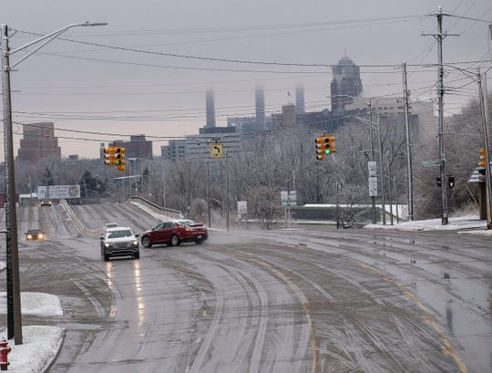 Travelers in the Lansing area find slushy roads as heavy wet snow covered the area overnight Sunday, Dec. 1, 2019. The forecast calls for rain and snow with little or no accumulation.
