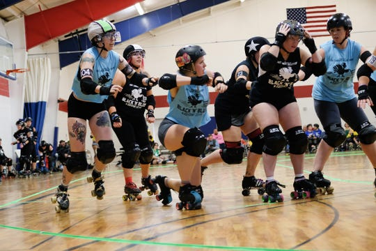 Roller Derby players from several teams and leagues form teams and skate together in the Black 'N' Blue Weekend 2019 Roller Derby tournament Saturday, Nov. 30, 2019.