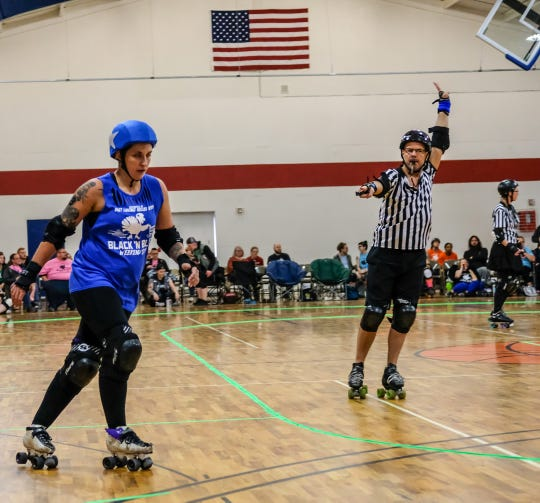 Mitten Maven league member Carina Millar, AKA Bam Bam Rebel, starts to pick up speed as a jammer in the Black 'N' Blue Weekend 2019 Roller Derby tournament Saturday, Nov. 30, 2019.