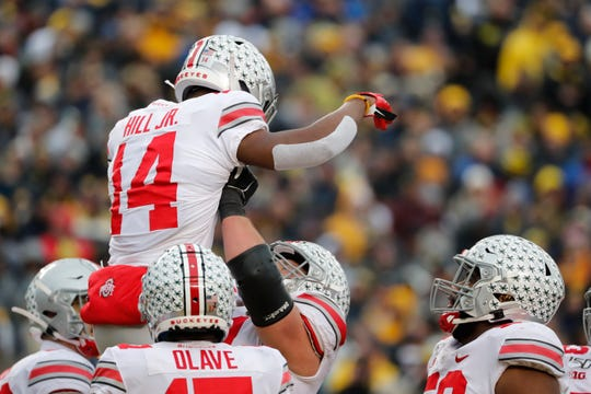 Ohio State's K.J. Hill celebrates with teammates after catching a second half touchdown pass in Saturday's 56-27 win over Michigan.